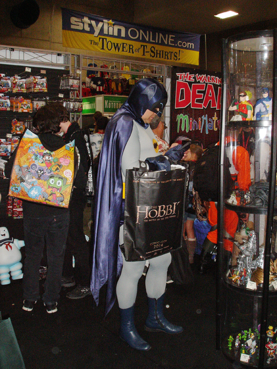 Batman on his phone while shopping