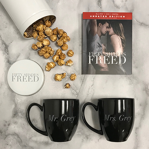 Fifty Shades Freed DVD, popcorn tin and mugs